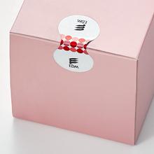 転写タイプ改ざん防止ラベルのご提案例:菓子箱の封かん(剥がす前)